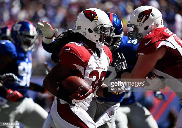 Running back Andre Ellington of the Arizona Cardinals carries the ball against the New York Giants during a game at MetLife Stadium on September 14...