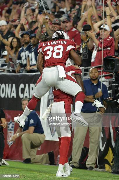 Running back Andre Ellington of the Arizona Cardinals reacts with wide receiver Jaron Brown after a first quarter touchdown during the NFL game...
