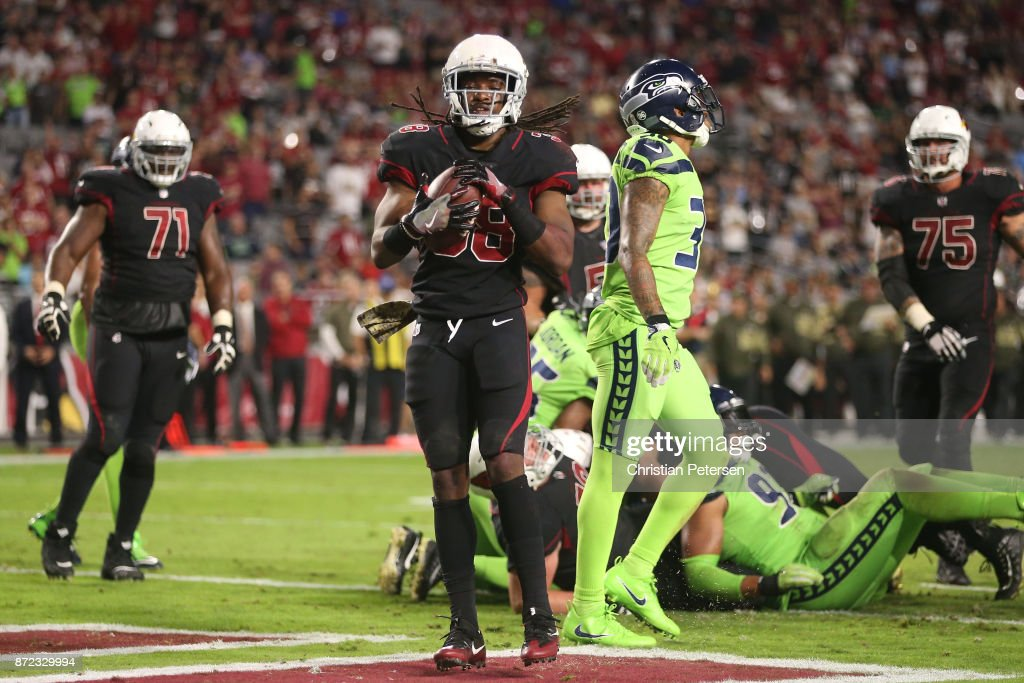 Running back Andre Ellington #38 of the Arizona Cardinals rushes a one yard touchdown in the second half of the NFL game against the Seattle Seahawks at University of Phoenix Stadium on November 9, 2017 in Glendale, Arizona. The Seattle Seahawks won 22-16.