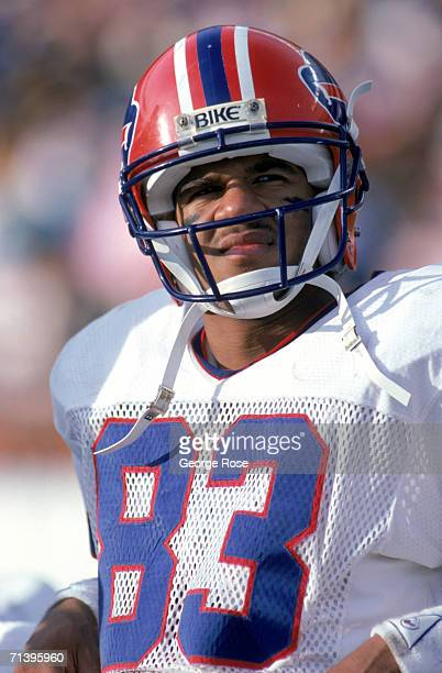 Running back Andre Reed of the Buffalo Bills looks on as he sits on the bench during a game against the San Diego Chargers at Jack Murphy Stadium on...