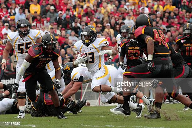 Running back Andrew Buie of the West Virginia Mountaineers rushes for a touchdown against the Maryland Terrapins during the first half at Byrd...