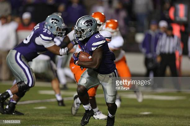 Running back Angelo Pease of the Kansas State Wildcats runs with the ball against the Oklahoma State Cowboys at Bill Snyder Family Football Stadium...