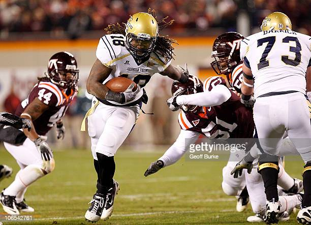 Running back Anthony Allen of the Georgia Tech Yellow Jackets runs with the ball as linebacker Bruce Taylor of the Virginia Tech Hokies chases at...