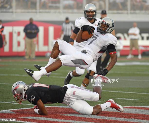 Running back Anthony Philyaw of the Howard Bison is tackled for a loss by defensive back Javin White of the UNLV Rebels during their game at Sam Boyd...