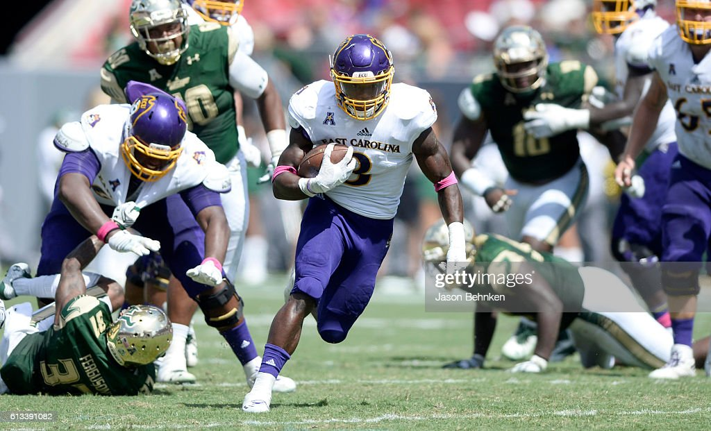 Running back Anthony Scott #3 of the East Carolina Pirates gains yards against the South Florida Bulls Wide during the 2nd quarter at Raymond James Stadium on October 8, 2016 in Tampa, Florida.