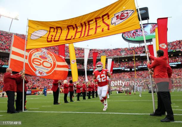 Running back Anthony Sherman of the Kansas City Chiefs runs onto the field during pregame prior to the game against the Baltimore Ravens at Arrowhead...