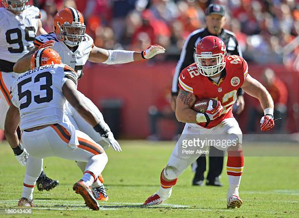 Running back Anthony Sherman of the Kansas City Chiefs rushes against pressure from linebacker Graig Robertson of the Cleveland Browns during the...