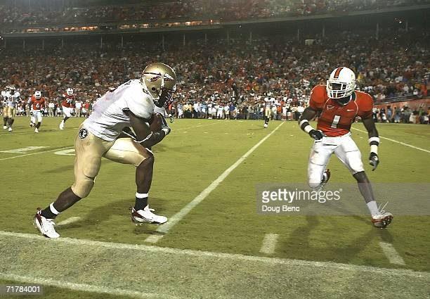 Running back Antone Smith of the Florida State Seminoles prepares to collide with safety Kenny Phillips of the University of Miami Hurricanes at the...