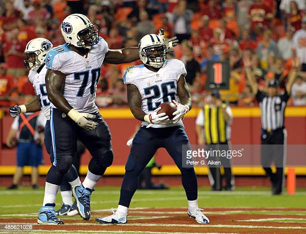 Running back Antonio Andrews of the Tennessee Titans celebrates a touchdown with guard Chance Warmack during the preseason game against the Kansas...