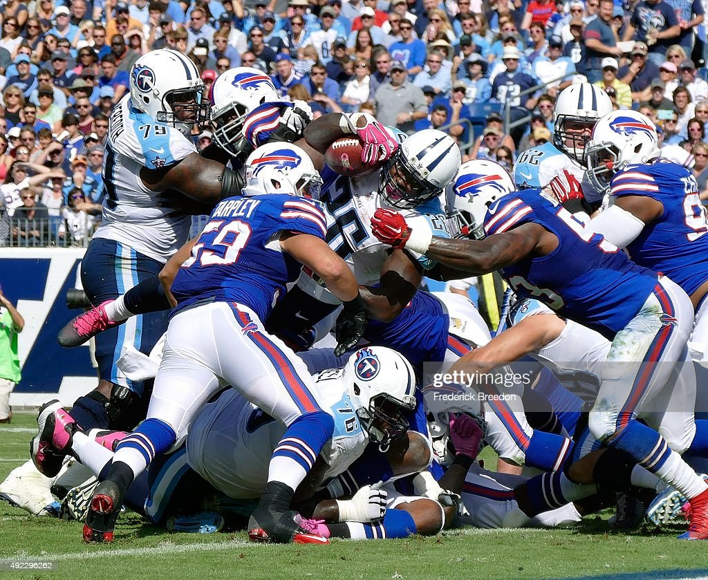 Running back Antonio Andrews #26 of the Tennessee Titans scores a touchdown against the Buffalo Billsduring the second half of a game at Nissan Stadium on October 11, 2015 in Nashville, Tennessee.