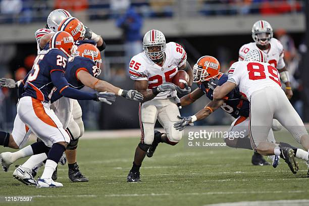 Running back Antonio Pittman of Ohio State looks for running room during action between the Ohio State Buckeyes and Illinois Fighting Illini at...