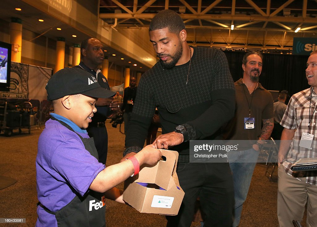 NFL running back Arian Foster of the Houston Texans attends the FedEx lemonade stand with Junior Achievement students in the Super Bowl XLVII Media Center, one of the most highly-trafficked venues of the Super Bowl city. The event celebrated the 10th season of the FedEx Air & Ground NFL Players of the Year awards and allowed the students to run their first business.