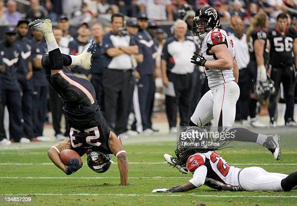 Running back Arian Foster of the Houston Texans is up ended by cornerback Dunta Robinson of the Atlanta Falcons on December 4 2011 at Reliant Stadium...