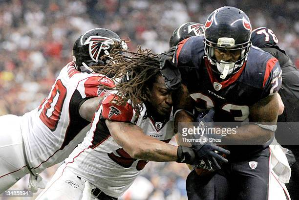 Running back Arian Foster of the Houston Texans rushes for a touchdown after breaking gthe tackle of outside linebacker Mike Peterson of the Atlanta...