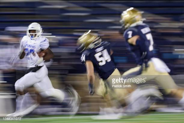 Running back Asa Martin of the Memphis Tigers rushes past linebacker Diego Fagot of the Navy Midshipmen during the first half at Navy-Marine Corps...