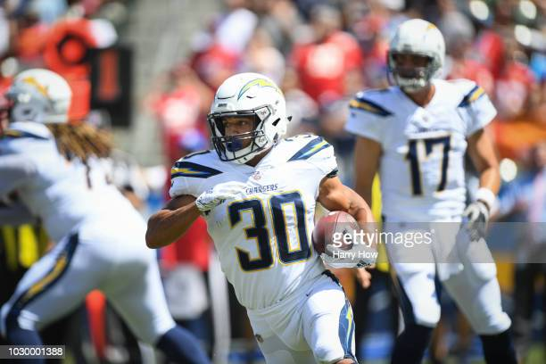 Running back Austin Ekeler of the Los Angeles Chargers carries the ball in the first quarter against the Kansas City Chiefs at StubHub Center on...