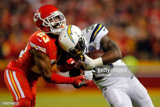 Running back Austin Ekeler of the Los Angeles Chargers carries the ball as cornerback Kendall Fuller of the Kansas City Chiefs defends during the...