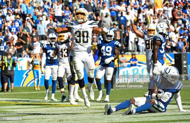Running back Austin Ekeler of the Los Angeles Chargers celebrates his touchdown against free safety Malik Hooker of the Indianapolis Colts in...