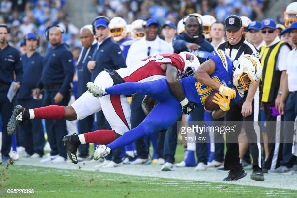 Running back Austin Ekeler of the Los Angeles Chargers is tackled by outside linebacker Haason Reddick of the Arizona Cardinals in the second quarter...