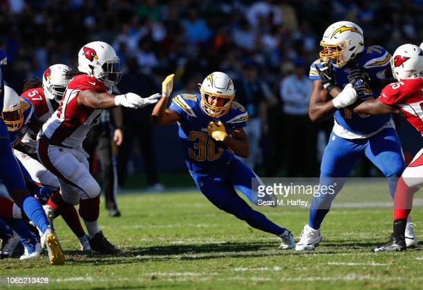 Running back Austin Ekeler of the Los Angeles Chargers runs the ball in the first quarter against the Arizona Cardinals at StubHub Center on November...