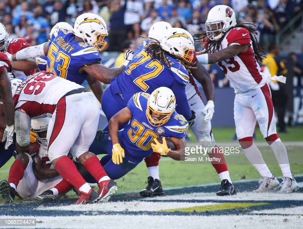 Running back Austin Ekeler of the Los Angeles Chargers scores a touchdown in the third quarter against the Arizona Cardinals at StubHub Center on...