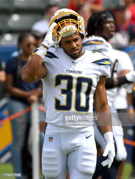 running back Austin Ekeler of the Los Angeles Chargers warms up before the game against the Houston Texans at Dignity Health Sports Park on September...
