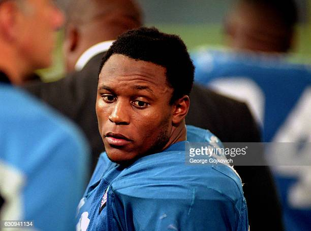 Running back Barry Sanders of the Detroit Lions looks on from the sideline during a game against the Minnesota Vikings at the Pontiac Silverdome on...