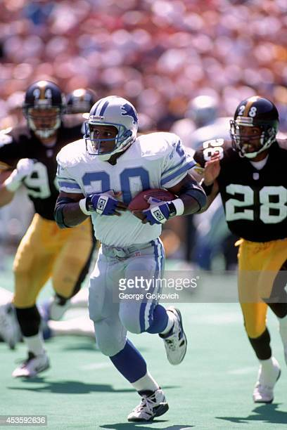Running back Barry Sanders of the Detroit Lions runs from defensive back Alvoid Mays of the Pittsburgh Steelers at Three Rivers Stadium on September...