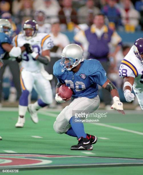 Running back Barry Sanders of the Detroit Lions runs with the football during a game against the Minnesota Vikings at the Pontiac Silverdome on...