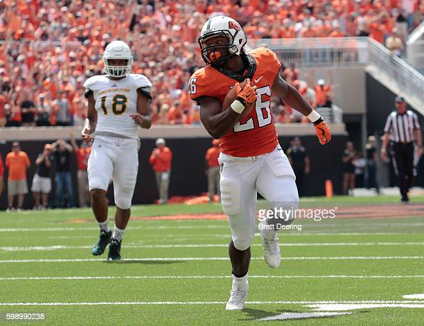 Running back Barry Sanders of the Oklahoma State Cowboys looks back over open field against the Southeastern Louisiana Lions September 3 2016 at...