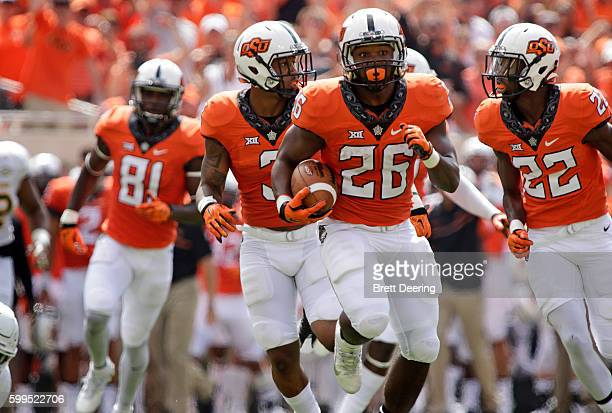 Running back Barry Sanders of the Oklahoma State Cowboys runs downfield during the game against the Southeastern Louisiana Lions September 3, 2016 at...