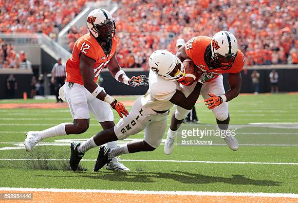 Running back Barry Sanders of the Oklahoma State Cowboys tries to score against the Southeastern Louisiana Lions September 3, 2016 at Boone Pickens...