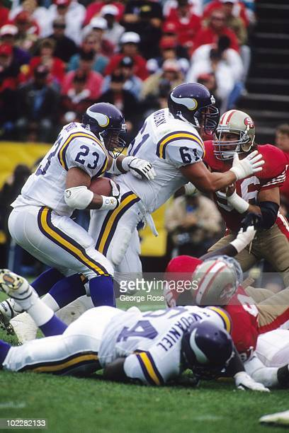 Running back Barry Word of the Minnesota Vikings runs behind his lead blocker guard Everett Lindsay against the San Francisco 49ers at Candlestick...
