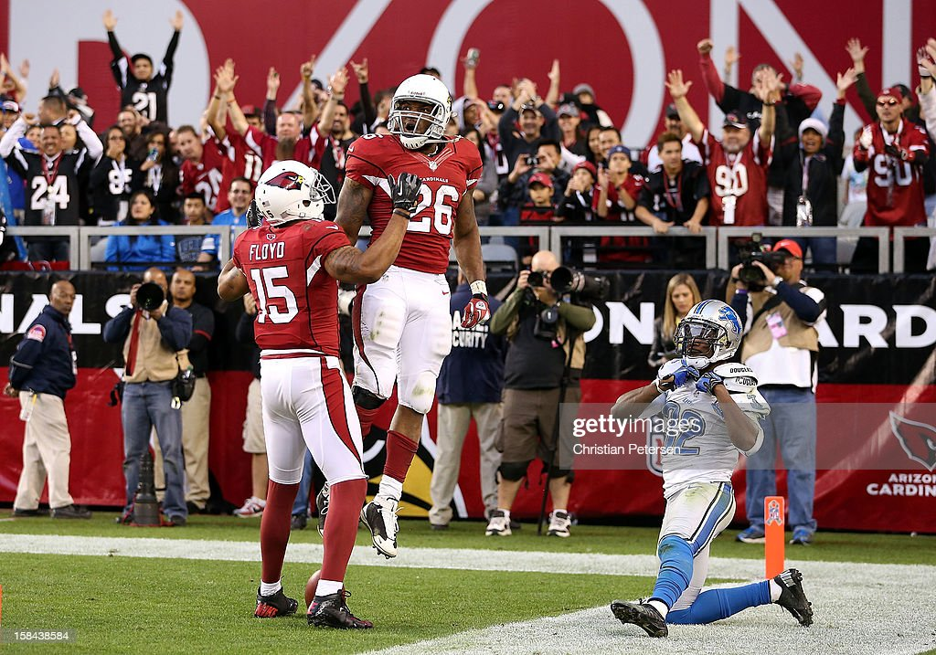 Running back Beanie Wells #26 of the Arizona Cardinals celebrates with wide receiver Michael Floyd #15 after Wells scored a 31 yard rushing touchdown against the Detroit Lions during the fourth quarter of the NFL game at the University of Phoenix Stadium on December 16, 2012 in Glendale, Arizona. The Cardinals defeated the Lions 38-10.