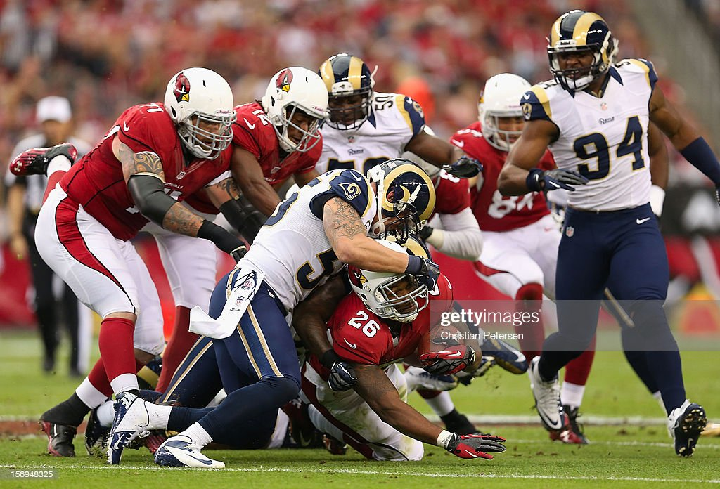 Running back Beanie Wells #26 of the Arizona Cardinals is tackled by middle linebacker James Laurinaitis #55 of the St. Louis Rams during the NFL game at the University of Phoenix Stadium on November 25, 2012 in Glendale, Arizona. The Rams defeated the Cardinals 31-17.