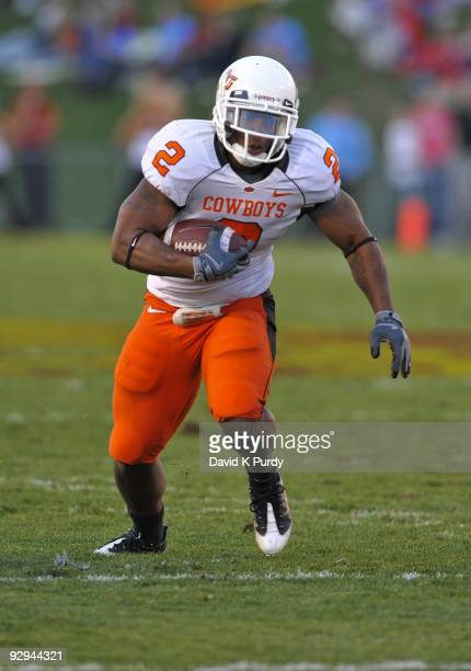 Running back Beau Johnson of the Oklahoma State Cowboys rushes for yards during the game against the Iowa State Cyclones at Jack Trice Stadium on...