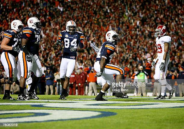 Running back Ben Tate of the Auburn Tigers celebrates after scoring a touchdown while taking on the Alabama Crimson Tide at Jordan-Hare Stadium on...