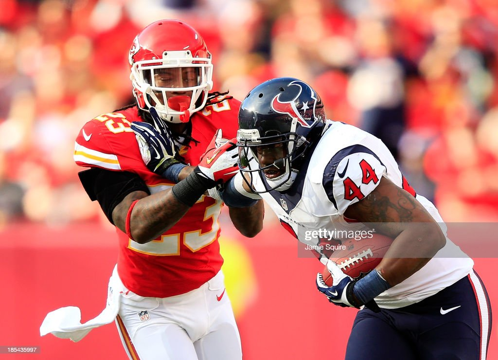 Running back Ben Tate #44 of the Houston Texans carries the ball as free safety Kendrick Lewis #23 of the Kansas City Chiefs defends during the game at Arrowhead Stadium on October 20, 2013 in Kansas City, Missouri.