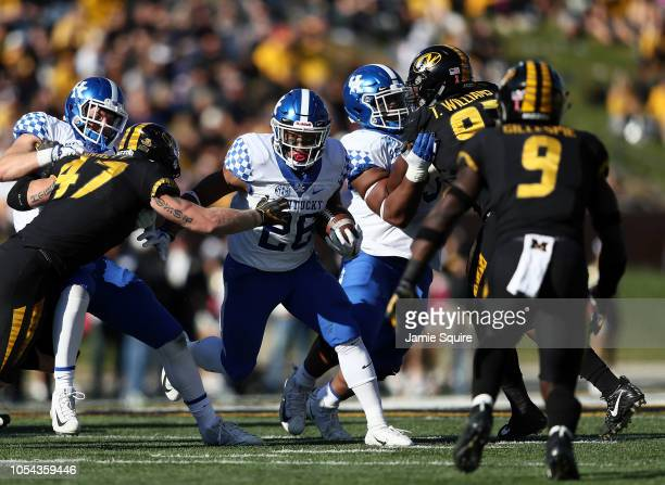 Running back Benny Snell Jr #26 of the Kentucky Wildcats carries the ball during the game against the Missouri Tigers at Faurot Field/Memorial...