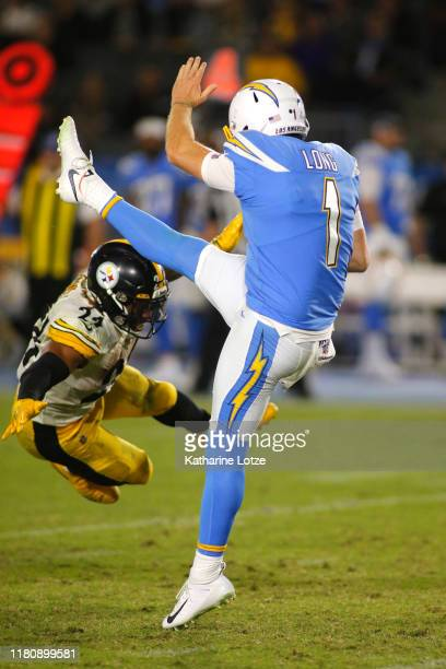 Running back Benny Snell of the Pittsburgh Steelers attempts to block a punt by punter Ty Long of the Los Angeles Chargers during the third quarter...
