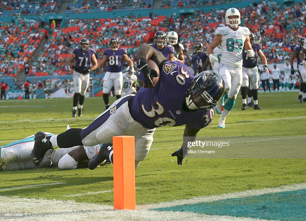 Running back Bernard Pierce #30 of the Baltimore Ravens dives unsuccessfully for the endzone against the Miami Dolphins in the fourth quarter during a game at Sun Life Stadium on December 7, 2014 in Miami Gardens, Florida.
