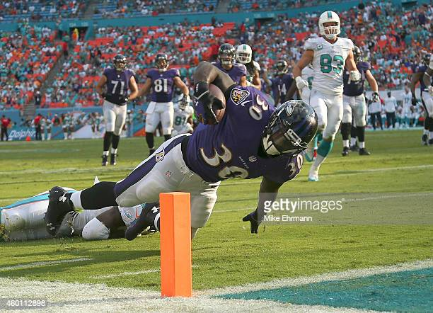 Running back Bernard Pierce of the Baltimore Ravens dives unsuccessfully for the endzone against the Miami Dolphins in the fourth quarter during a...