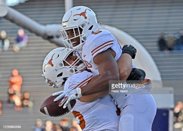 Running back Bijan Robinson of the Texas Longhorns celebrates after scoring a touchdown against the Kansas State Wildcats during the first half at...