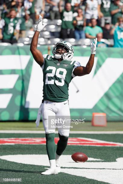 Running back Bilal Powell of the New York Jets celebrates his toudchdown against the Miami Dolphins in the third quarter at MetLife Stadium on...