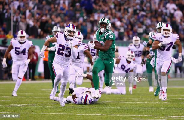 Running back Bilal Powell of the New York Jets runs the ball against strong safety Micah Hyde of the Buffalo Bills during the third quarter of the...
