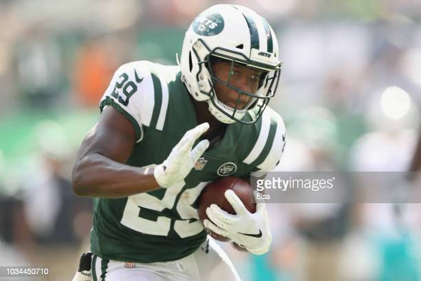 Running back Bilal Powell of the New York Jets runs the ball in for a touchdown against the Miami Dolphins in the third quarter during the first half...