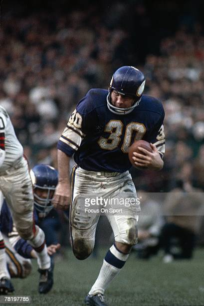 Running back Bill Brown of the Minnesota Vikings carries the ball during a circa late 1960's NFL football game against the Cleveland Browns Brown...