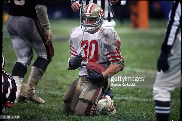 Running back Bill Ring of the San Francisco 49ers looks up from the field after he was tackled during a game against the Cleveland Browns at...