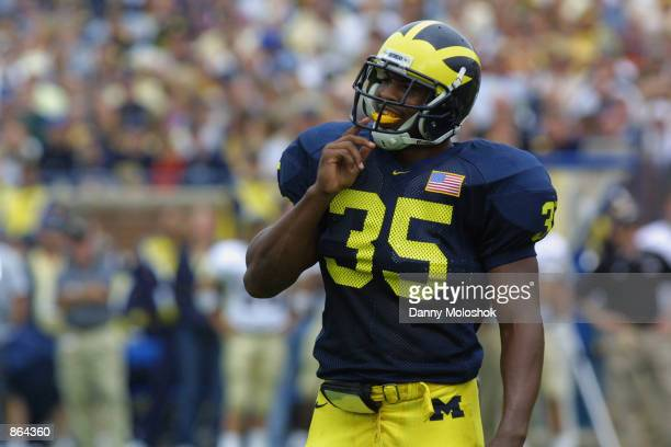 Running back Bj Askew of the Michigan Wolverines takes out his mouthguard during the NCAA football game against the Western Michigan Broncos on...