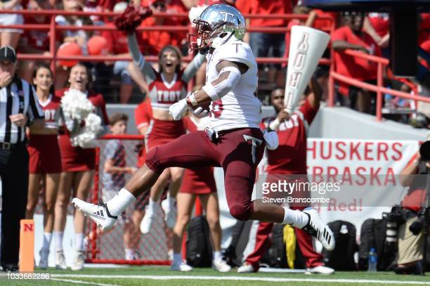 Running back BJ Smith of the Troy Trojans scores on a run in the first half against the Nebraska Cornhuskers at Memorial Stadium on September 15 2018...